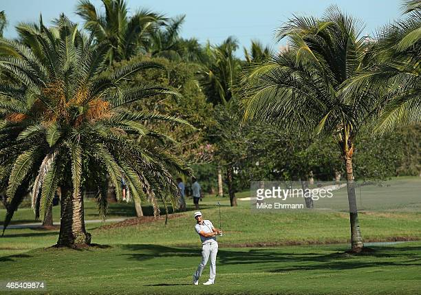 Dustin Johnson of the United States plays a shot on the seventh hole during the second round of the World Golf Championships-Cadillac Championship at...