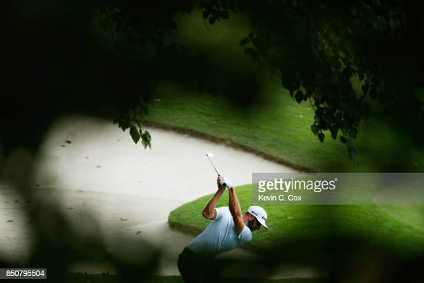 Dustin Johnson of the United States plays a shot on the sixth hole during the first round of the TOUR Championship at East Lake Golf Club on...