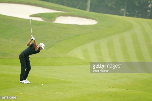 Dustin Johnson of the United States plays a shot on the third hole during the final round of the WGC HSBC Champions at Sheshan International Golf...