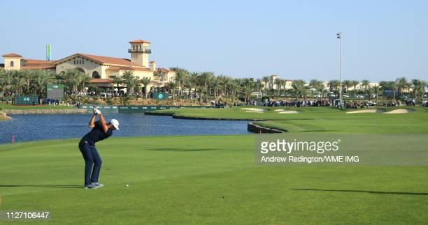 Dustin Johnson of The United States plays his second shot on the 18th hole during Day four of the Saudi International at the Royal Greens Golf...