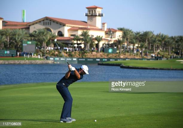 Dustin Johnson of The United States plays his second shot on the 18th hole during Day four of the Saudi International at the Royal Greens Golf &...
