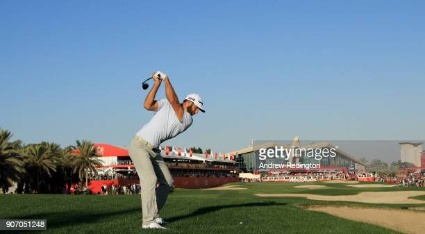 Dustin Johnson of the United States plays his second shot on the 18th hole during round two of the Abu Dhabi HSBC Golf Championship at Abu Dhabi Golf...