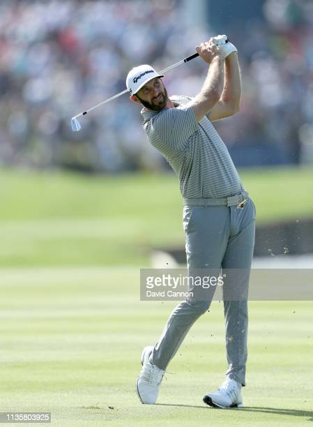 Dustin Johnson of the United States plays his second shot on the par 4 18th hole during the first round of the 2019 Players Championship held on the...