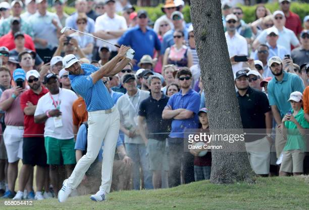 Dustin Johnson of the United States plays his second shot on the par 5, sixth hole in his match against John Rahm of Spain during the final of the...