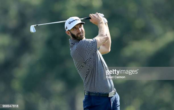 Dustin Johnson of the United States plays his second shot on the par 4 14th hole during the first round of the THE PLAYERS Championship on the...