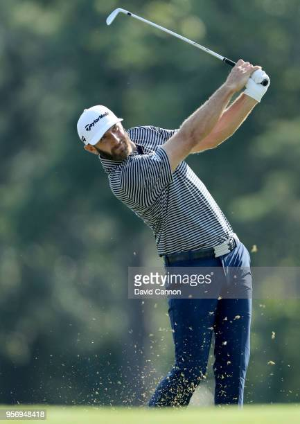Dustin Johnson of the United States plays his second shot on the par 4, 14th hole during the first round of the THE PLAYERS Championship on the...