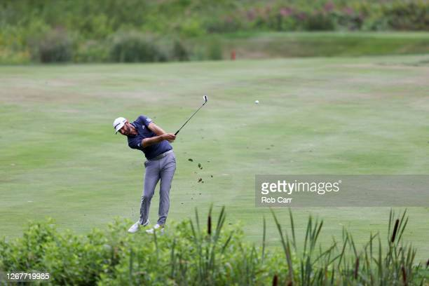 Dustin Johnson of the United States plays his second shot on the fifth hole during the third round of The Northern Trust at TPC Boston on August 22,...