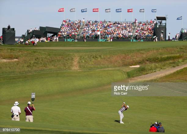Dustin Johnson of the United States plays his second shot on the ninth green during the third round of the 2018 U.S. Open at Shinnecock Hills Golf...