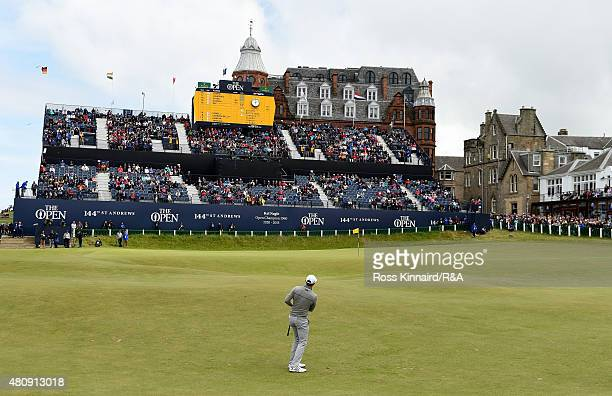 Dustin Johnson of the United States plays his second shot to the 18th hole during the first round of the 144th Open Championship at The Old Course on...