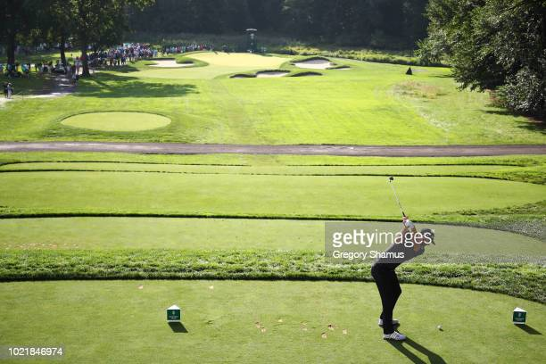 Dustin Johnson of the United States plays his shot from the 11th tee during the first round of The Northern Trust on August 23 2018 at the Ridgewood...