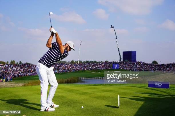 Dustin Johnson of the United States plays his shot from the 11th tee during the afternoon foursome matches of the 2018 Ryder Cup at Le Golf National...