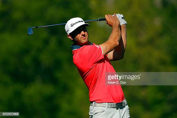 Dustin Johnson of the United States plays his shot from the 12th tee during the final round of the 2016 Masters Tournament at Augusta National Golf...