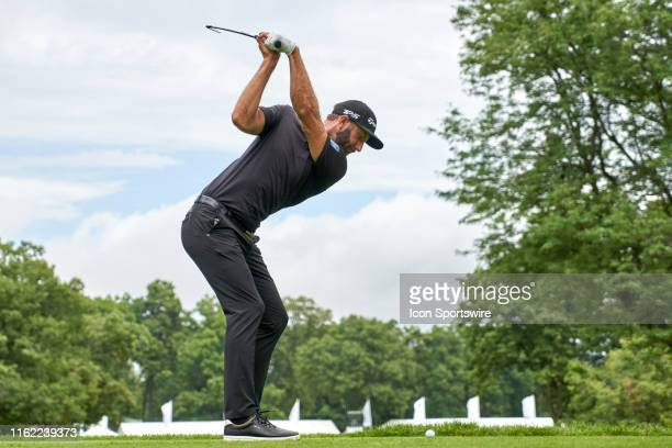 Dustin Johnson of the United States plays his shot from the 13th tee during the third round of the BMW Championship at Medinah Country Club on August...