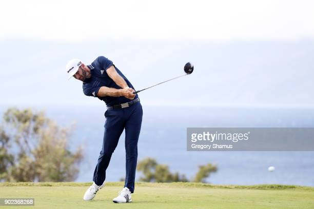 Dustin Johnson of the United States plays his shot from the 13th tee uring the final round of the Sentry Tournament of Champions at Plantation Course...