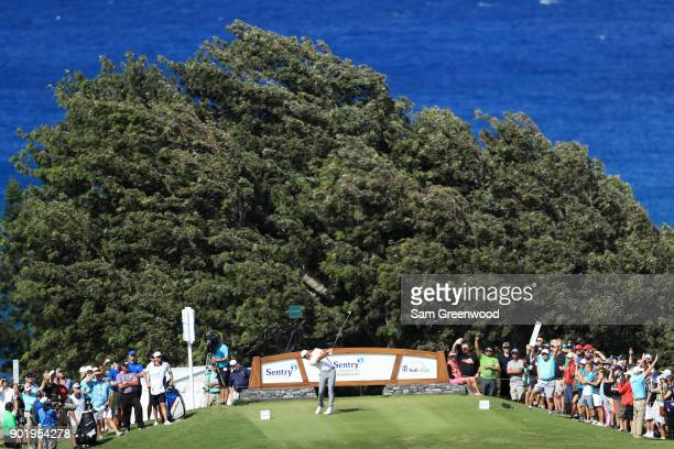 Dustin Johnson of the United States plays his shot from the 14th tee during the third round of the Sentry Tournament of Champions at Plantation...