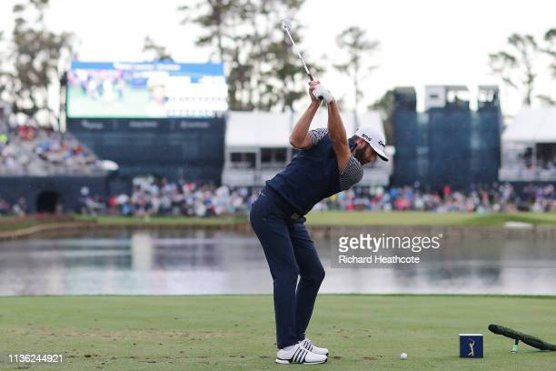 Dustin Johnson of the United States plays his shot from the 17th tee during the third round of The PLAYERS Championship on The Stadium Course at TPC...