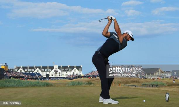 Dustin Johnson of the United States plays his shot from the 18th tee during the first round of the 147th Open Championship at Carnoustie Golf Club on...
