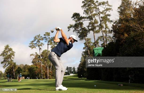 Dustin Johnson of the United States plays his shot from the 18th tee during the continuation of the first round of the Masters at Augusta National...