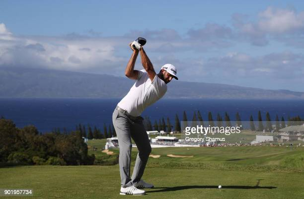 Dustin Johnson of the United States plays his shot from the 18th tee during the third round of the Sentry Tournament of Champions at Plantation...
