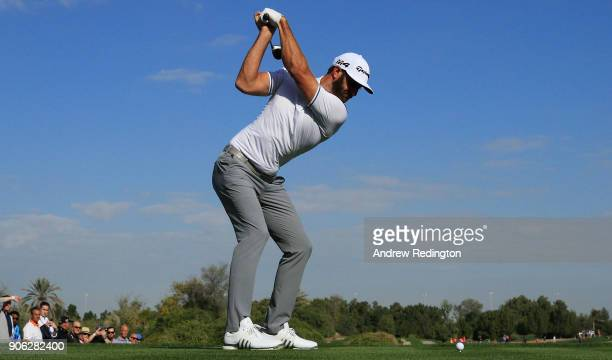 Dustin Johnson of the United States plays his shot from the 18th tee during round one of the Abu Dhabi HSBC Golf Championship at Abu Dhabi Golf Club...