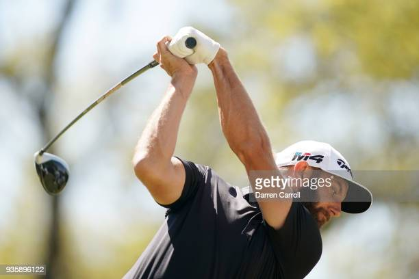 Dustin Johnson of the United States plays his shot from the eighth tee during the first round of the World Golf ChampionshipsDell Match Play at...