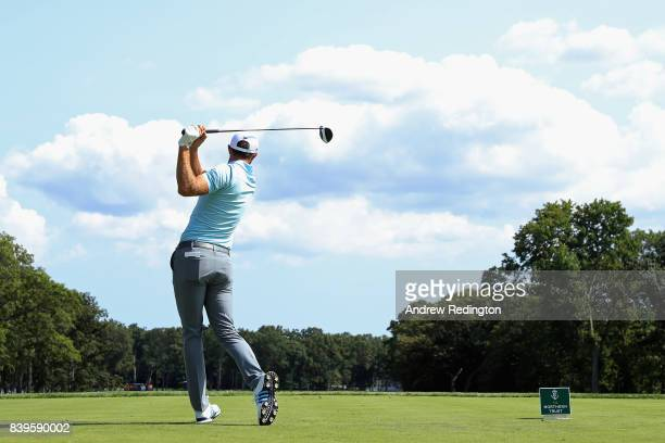 Dustin Johnson of the United States plays his shot from the fifth tee during round three of The Northern Trust at Glen Oaks Club on August 26 2017 in...