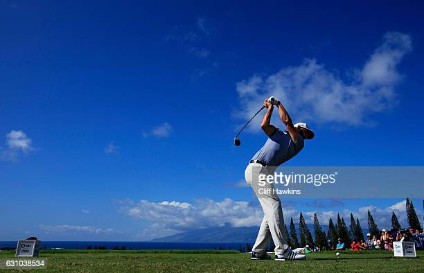Dustin Johnson of the United States plays his shot from the first tee during the first round of the SBS Tournament of Champions at the Plantation...
