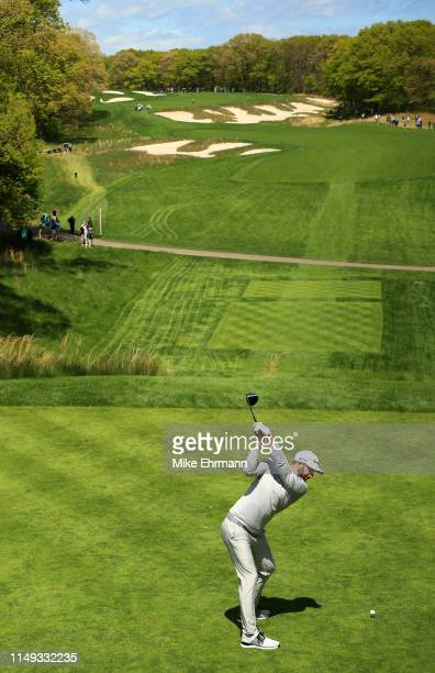 Dustin Johnson of the United States plays his shot from the fourth tee during a practice round prior to the 2019 PGA Championship at the Bethpage...