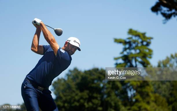 Dustin Johnson of the United States plays his shot from the fourth tee during the final round of the TOUR Championship at East Lake Golf Club on...