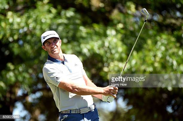 Dustin Johnson of the United States plays his shot from the fourth tee during the third round of the 2016 Masters Tournament at Augusta National Golf...