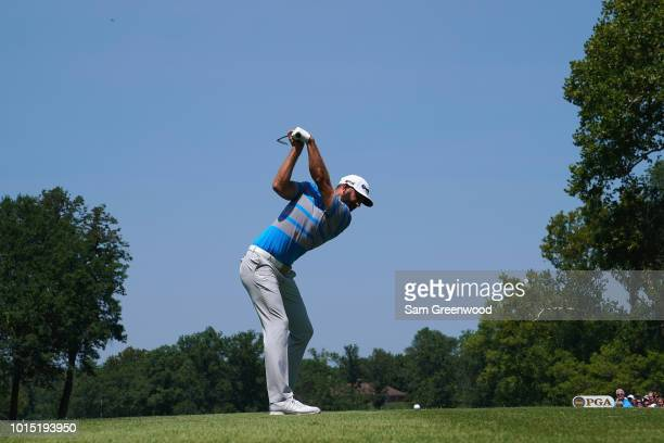 Dustin Johnson of the United States plays his shot from the second tee during the third round of the 2018 PGA Championship at Bellerive Country Club...