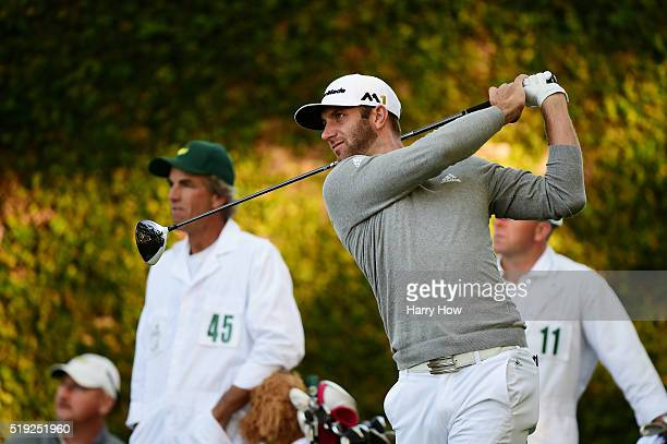 Dustin Johnson of the United States plays his shot from the second tee during a practice round prior to the start of the 2016 Masters Tournament at...
