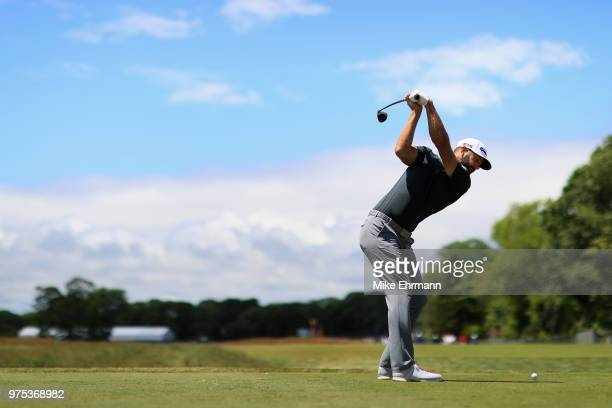 Dustin Johnson of the United States plays his shot from the sixth tee during the second round of the 2018 US Open at Shinnecock Hills Golf Club on...