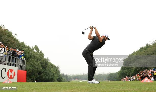 Dustin Johnson of the United States plays his shot from the tenth tee during the final round of the WGC HSBC Champions at Sheshan International Golf...
