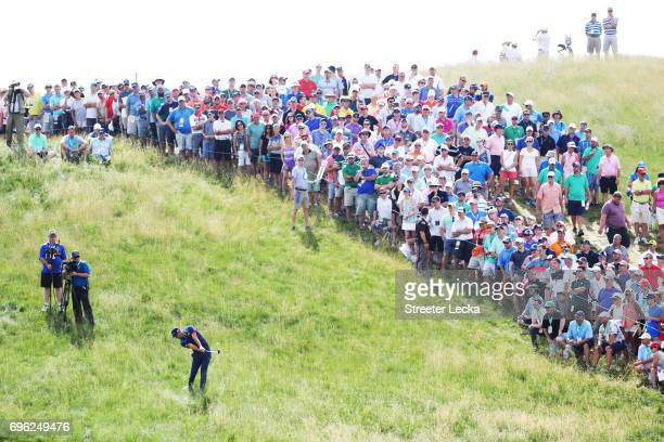 Dustin Johnson of the United States plays his shot on the 12th hole during the first round of the 2017 US Open at Erin Hills on June 15 2017 in...