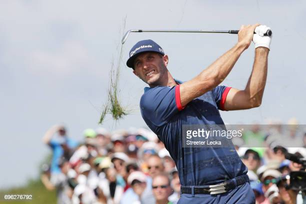 Dustin Johnson of the United States plays his shot on the 17th hole during the first round of the 2017 US Open at Erin Hills on June 15 2017 in...