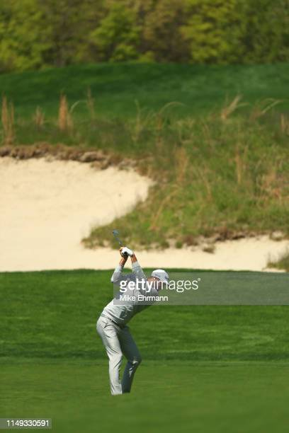 Dustin Johnson of the United States plays his shot on the fourth hole during a practice round prior to the 2019 PGA Championship at the Bethpage...