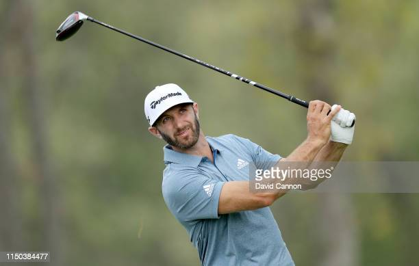 Dustin Johnson of the United States plays his tee shot on the 12th hole during the final round of the 2019 PGA Championship on the Black Course at...