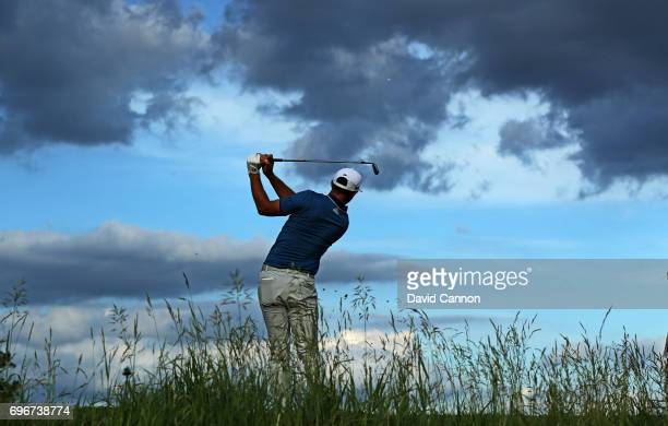 Dustin Johnson of the United States plays his tee shot on the par 3 16th hole during the second round of the 117th US Open Championship at Erin Hills...