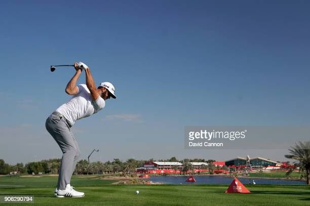 Dustin Johnson of the United States plays his tee shot on the par 5 18th hole during the first round of the 2018 Abu Dhabi HSBC Golf Championship at...