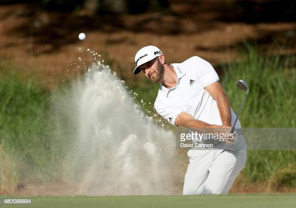 Dustin Johnson of the United States plays his third shot at the par 4 14th hole during the first round of THE PLAYERS Championship on the Stadium...