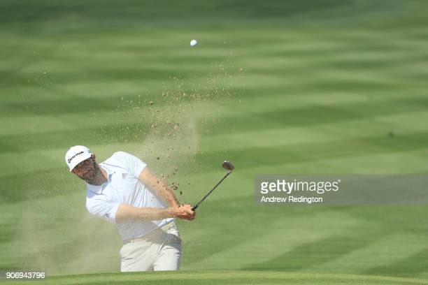Dustin Johnson of the United States plays his third shot from a bunker on the second hole during round two of the Abu Dhabi HSBC Golf Championship at...