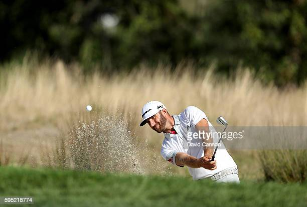 Dustin Johnson of the United States plays his third shot on the 12th hole during the first round of The Barclays in the PGA Tour FedExCup PlayOffs on...