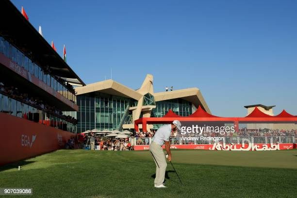 Dustin Johnson of the United States plays his third shot on the 18th hole during round two of the Abu Dhabi HSBC Golf Championship at Abu Dhabi Golf...
