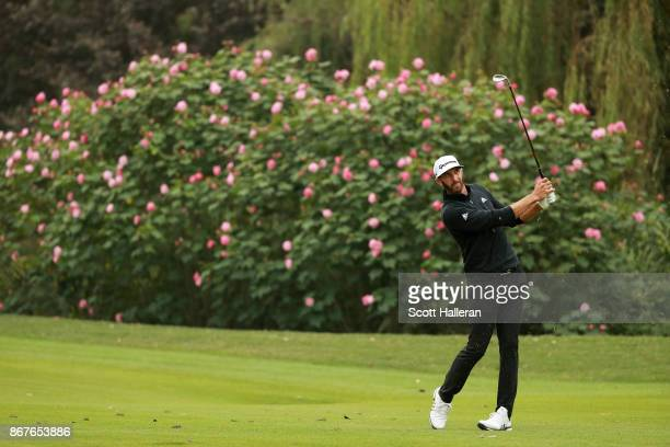 Dustin Johnson of the United States plays his third shot on the eighth hole during the final round of the WGC HSBC Champions at Sheshan International...