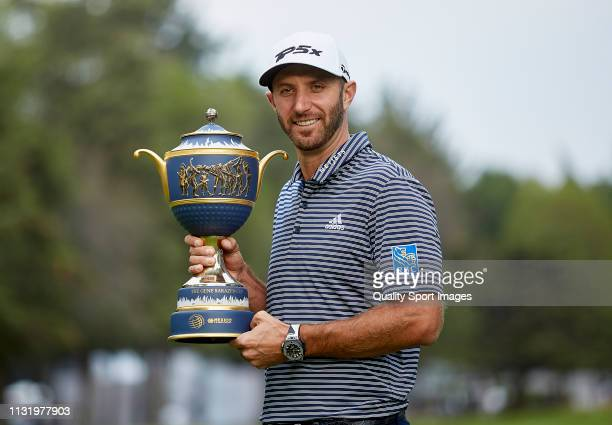Dustin Johnson of the United States poses with the Gene Sarazen Cup after winning during the final round of World Golf ChampionshipsMexico...