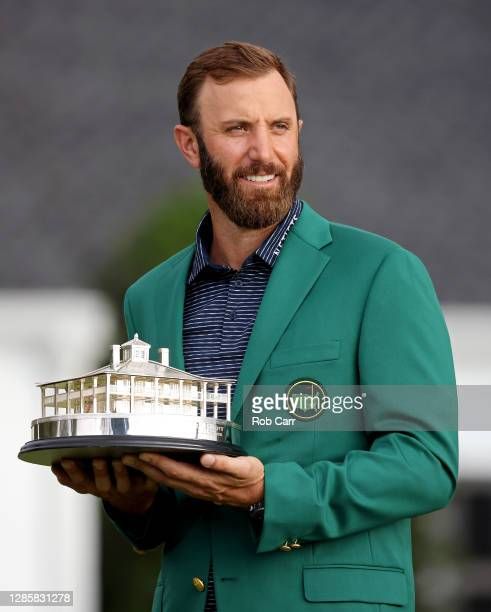 Dustin Johnson of the United States poses with the Masters Trophy during the Green Jacket Ceremony after winning the Masters at Augusta National Golf...