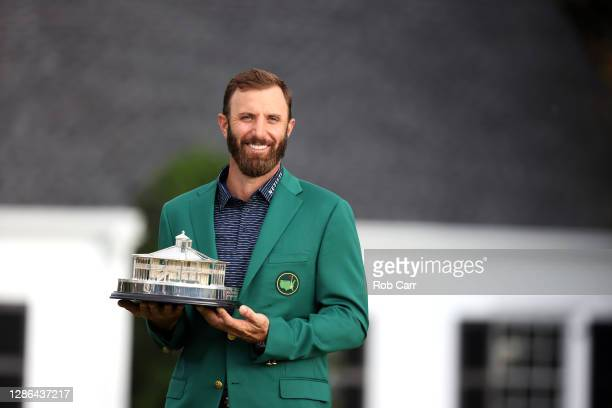 Dustin Johnson of the United States poses with the Masters Trophy during the Green Jacket Ceremony after winning the Masters during the final round...