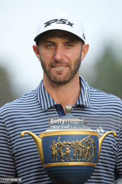 Dustin Johnson of the United States poses with the trophy after winning the World Golf Championships-Mexico Championship at Club de Golf Chapultepec...