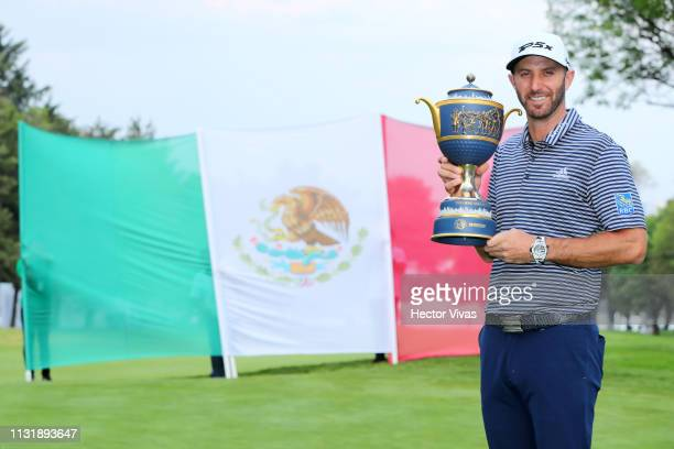Dustin Johnson of the United States poses with the trophy after winning the World Golf ChampionshipsMexico Championship at Club de Golf Chapultepec...